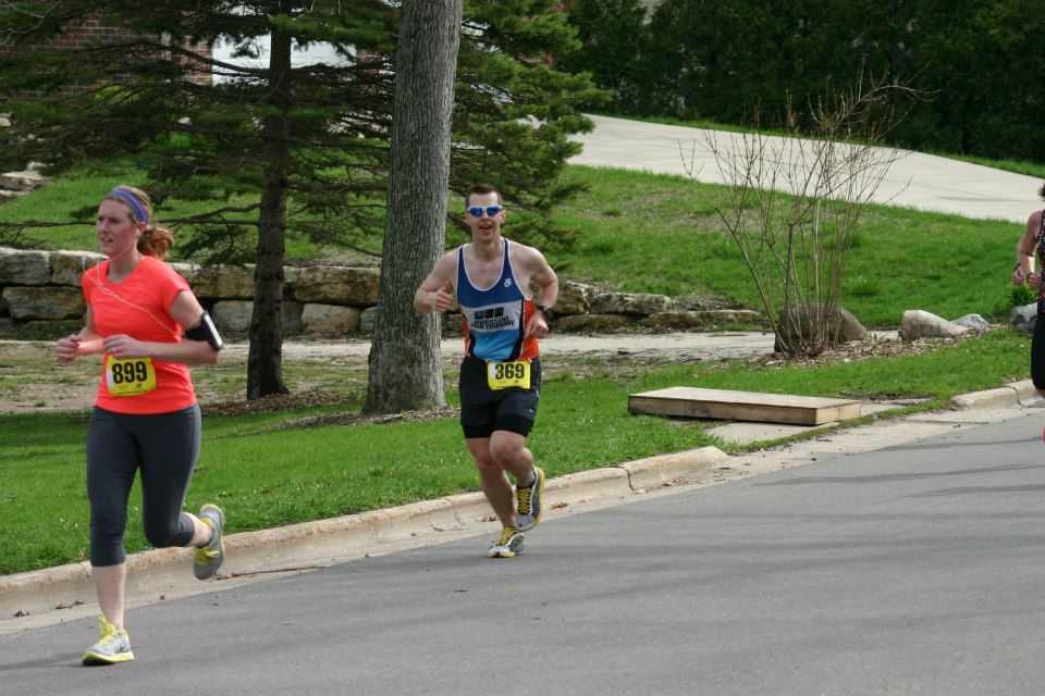 Justin G. full of smiles as he runs his way to a 7 min PR at the Monona 20K this past Saturday.  Great work!